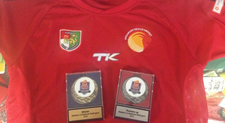 Photo of a signed Singapore team shirt, plus Winners and Runners-up medals